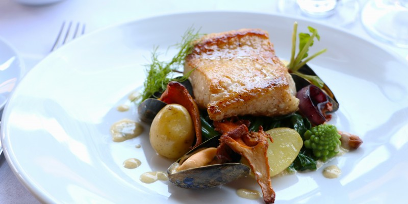 pan fried Loup de Mer with butted spinach, Pernod steamed mussels, chanterelle & romanesco.